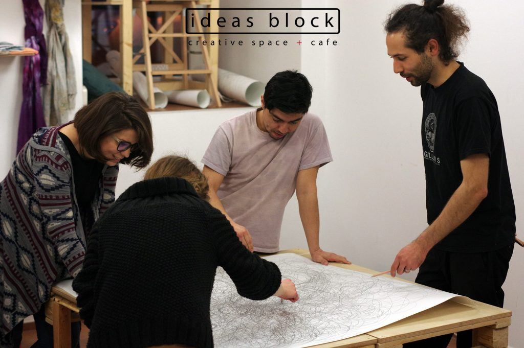 Artist Paul Takahashi conducting the experimental drawing workshop